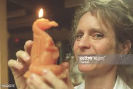 Silvia Grady, of St. Christopher's Hive Candle Co. holds a candle ...