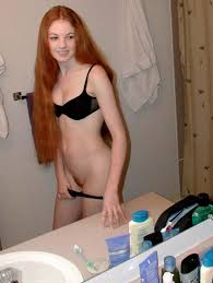 Redhead girl gets naked
