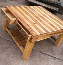 reclaimed wood pallet furniture. here is a coffee table i constructed from two smaller pallets it complete with four drawers to keep completely pallet inspired used finger holes reclaimed wood furniture e