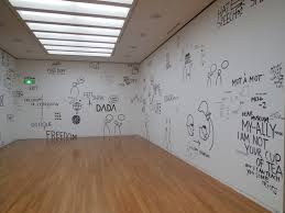 dear artist dan perjovschi white indoor wall dear museum installation at