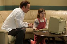 rd time s the charm steve jobs shines in the hands of sorkin michael fassbender left as steve jobs and makenzie moss as a young lisa jobs