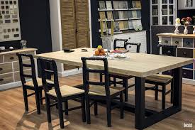 modern country dining room dark wooden table and chairs light wood flooring bamboo drawers