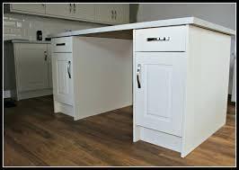 laminate flooring under kitchen cabinets downs harvest is installing