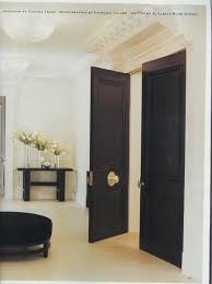 black doors with br pretty with white walls