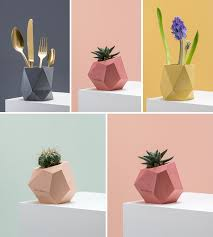 these colorful concrete planters and vases add a geometric touch