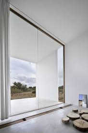 Large glass window. Es Pujol de S'Era by Mari Castell, Arquitecte. Large  floor-to-ceiling ...