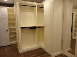 custom walk in closet white finishes and dark hardware