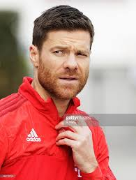fc bayern muenchen training session munich bayern and xabi alonso of fc bayern muenchen arrives for training at fc bayern muenchen training grounds on