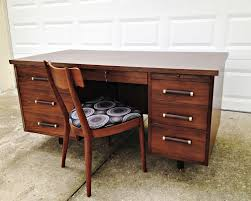 walnut wood mid century modern executive desk with six drawers and chair