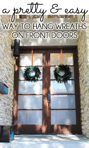 hang wreaths on front doors