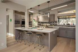 exposed lighting. traditional kitchen with large ceramic tile, hardwood floors, flush light, silestone blanco maple exposed lighting e