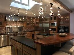 kitchen square track lighting for vaulted ceiling with skylight and 3 pendant lamps over island flexible