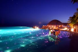 Infinity Pool with Dining And LED Lights Huvafen Fushi Resort in