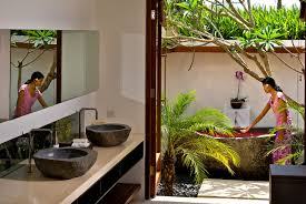 magnificent outdoor bathroom with stone sink basins also frameless mirror