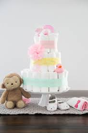 a simple diy diaper cake tutorial showing you in photos and how to make a