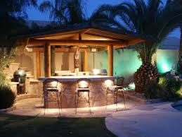 solid roof outdoor kitchen with pergola