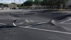 winter haven police are at the scene of a possible sinkhole in the parking lot of