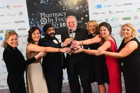 meet your winners pharmacy in focus prabh singh head of retail s idis celebrates paul hughes and the team from hughes pharmacy