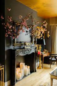 i love the clever use of candles and a fake mantle to give the illusion of a fireplace beautiful wall color too great for a master bedroom with no