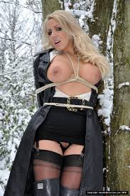 Plenty of outdoor fun in the snow with this tied up blonde slut.