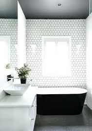 black hexagon tile bathroom dark grey floors a dark ceiling and white hex tiles with black