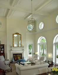 living room with high ceiling high pitched ceiling view living room high ceiling lighting