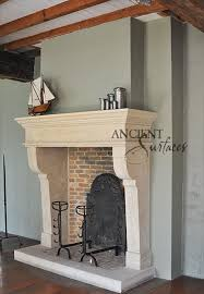 this simple limestone carved fireplace is tuscan in design installed with a thick stone hearth ad