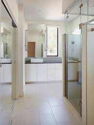 view in gallery bathroom with mirrored closets