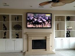 install tv over fireplace wiring living room ceiling fan mounting bookcase decor flat screen stone brick smlf mounting
