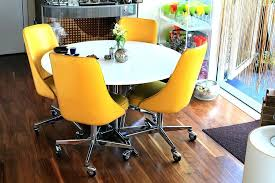 rolling dining chairs. Kitchen Table With Rolling Chairs Inspired By The Couples First Major Furniture Purchase In States . Dining S