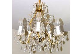 brass chandelier turned pretty white crystal chandelierfrom it s overflowing