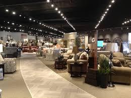 throughout new store janosik went open floor plan clean layout and dark ceilings keep eyes focused furniture JPG