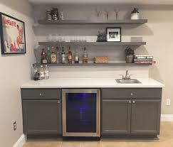 floating kitchen shelves brown checd wall tile natural wood plank backsplash dark brown rolled sleeve couch stainless steel coffee maker