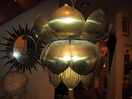 long a symbol of purity beauty and rebirth this lotus shaped brass pendant light is