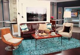 marvelous living room with elegant dark brown leather couch featuring rattan wicker armchair with cool blue patterned boho style rug and simple glossy