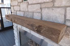this mantel was milled from a piece of driftwood and the fresh cuts were stained to