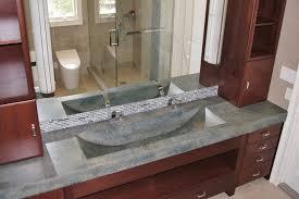 bathroom featuring stonehenge countertop concrete vanity barrel sink 7 images