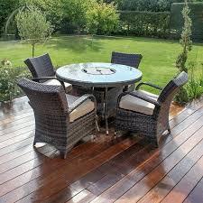 maze rattan garden furniture texas 4 seat round ice bucket table set