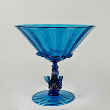 a large blue venetian glass footed bowl likely salviati with ribbed swirl design in the
