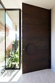 oversized dark wood door with a glass part