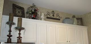 furniture decorating above kitchen cabinets