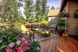 outdoor rugs with traditional deck and throw pillows patio furniture hanging basket plants container plants wood flooring