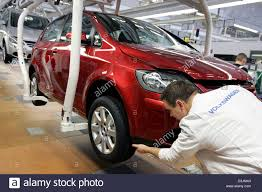 dpa) - An employee of Volkswagen (VW) at work on a VW Golf Plus at ...