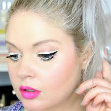 modern mod 60s makeup look with bold graphic black and white eye liner