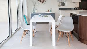 white gloss 4 seater table and eames style dining chairs uk throughout chair prepare 16