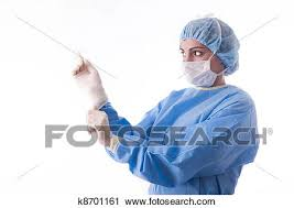 surgeon nurse stock photography of female surgeon or nurse putting on sterile