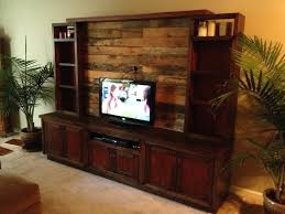 custom made entertainment center with pallet wood wall fireplace