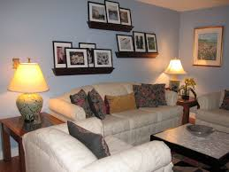 Living Room With Wall Shelves And Cordless Table Lamps Useful - Livingroom lamps