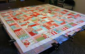 Christa's Quilt Along 1.4 – Backing and Basting Your Jelly Roll ... & Layered Quilt Adamdwight.com