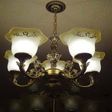 antique chandelier and wall lights